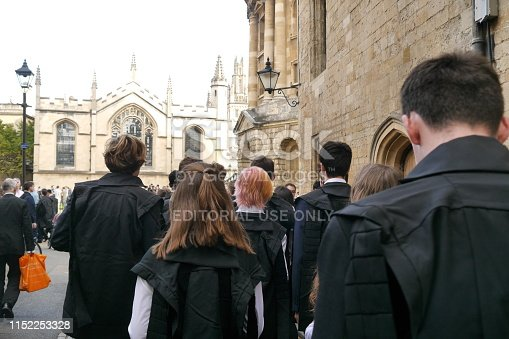 A group of new University of Oxford Students walk towards the Radcliffe Camera after being matriculated into the university in October 2018.