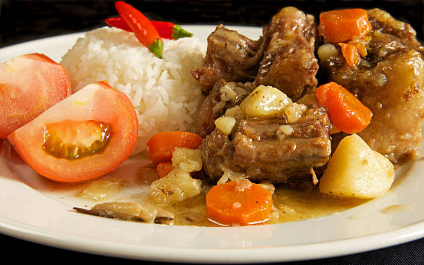 Oxtail Stew with Rice Oxtail with white rice and slice of tomato menu ragout stock pictures, royalty-free photos & images