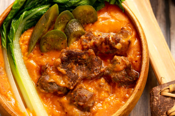 Oxtails in Peanut Gravy. Filipino flavor. Kare-Kare on brown bowl. Oxtails in Peanut Gravy. Filipino flavor. Kare-Kare on brown bowl. kare-kare stock pictures, royalty-free photos & images