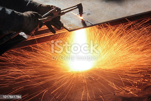 istock Oxy-fuel cutting. In oxy-fuel cutting, a torch is used to heat metal to its kindling temperature. A stream of oxygen is then trained on the metal, burning it into a metal oxide that flows out of the kerf as slag. 1017641784