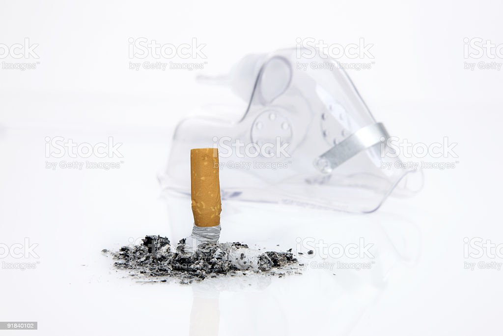 Oxygen mask with crushed Cigaret royalty-free stock photo