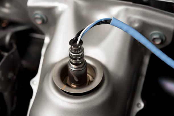 Oxygen sensor on new modern ca Oxygen sensor on new modern ca oxygen stock pictures, royalty-free photos & images