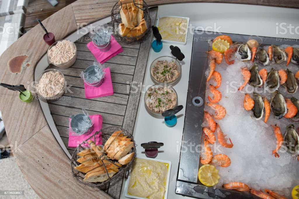 Oyster and shrimps on ice in buffet line at hotel stock photo