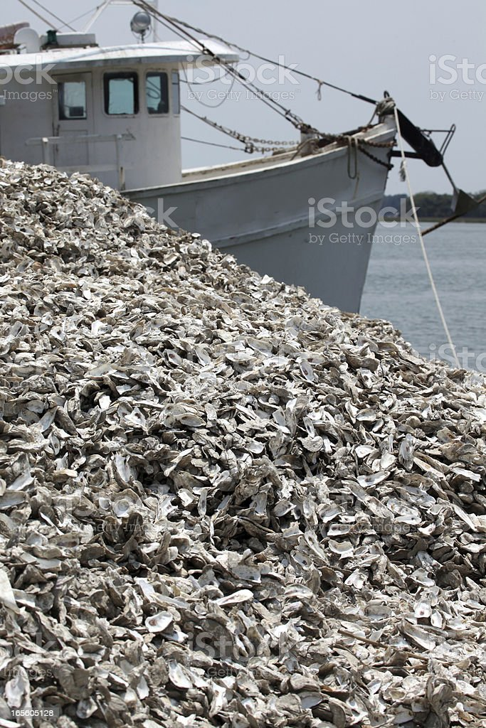 Oyster Boat and shells stock photo