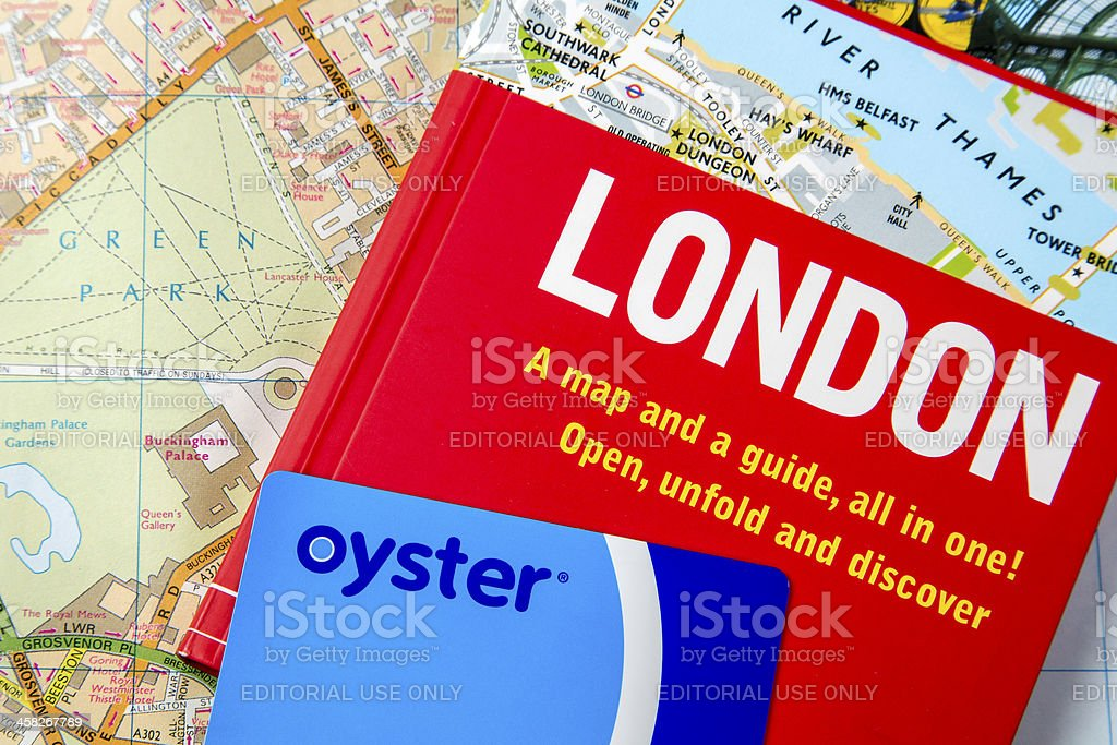 Oyster Card on a London Guide Book and Map royalty-free stock photo