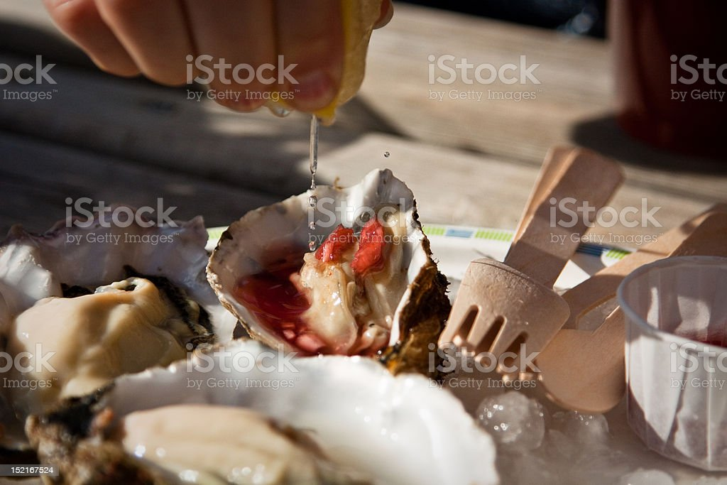 Oyster eating in Whitstable stock photo