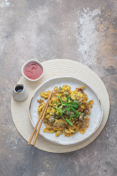 Oyster Omelette Served on white plate, copy space stock photo