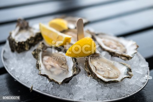 istock Oyster on Plate with Lemon. 926030076