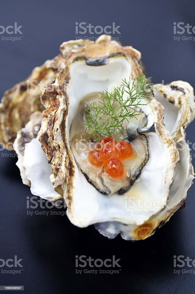 Oyster with dill and salmon roe royalty-free stock photo