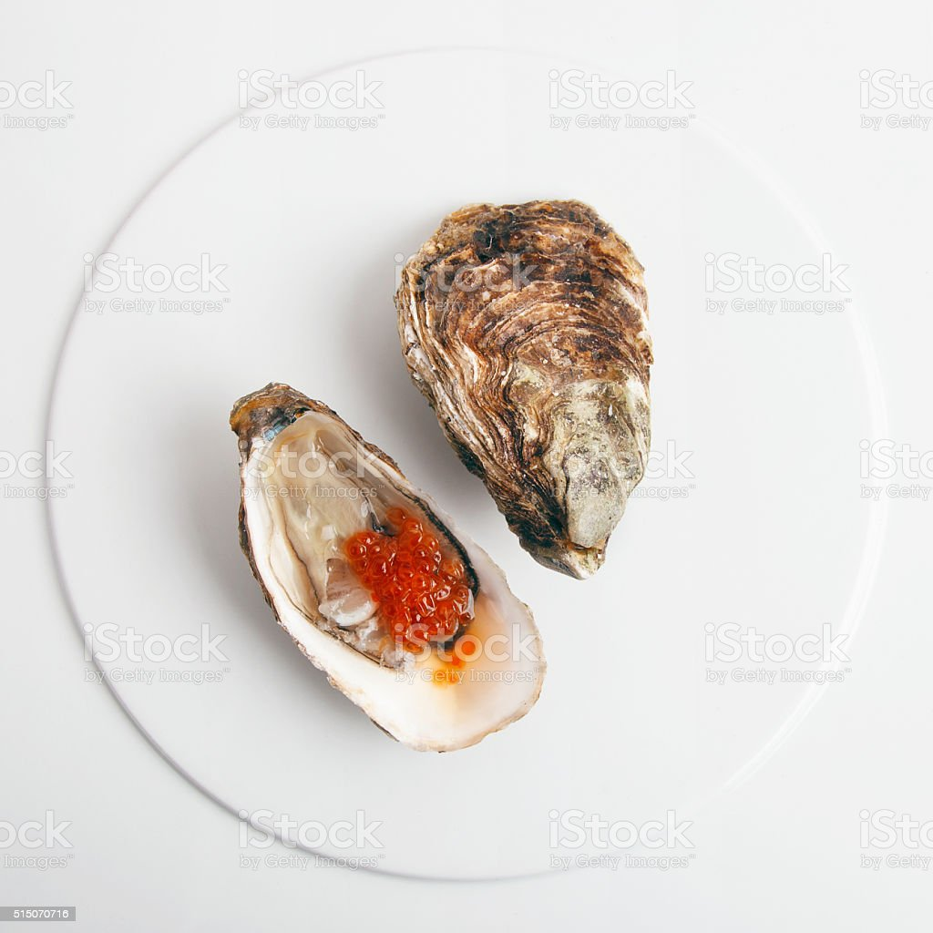 Oyster with red caviar stock photo
