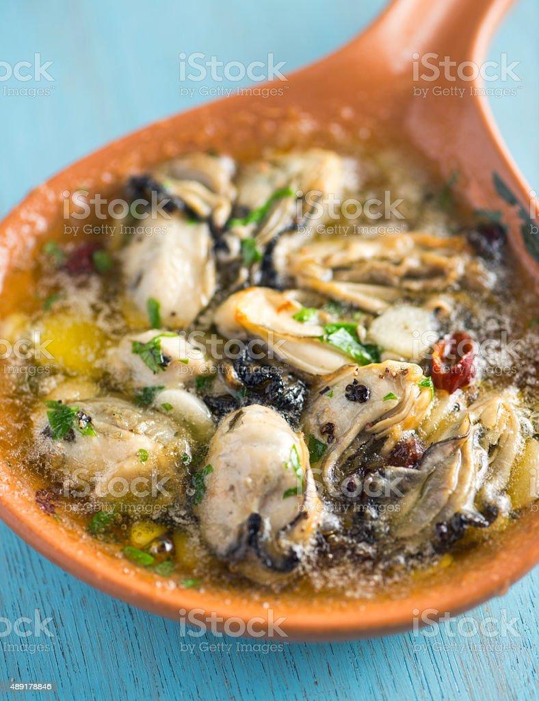 Oysters Ajillo stock photo