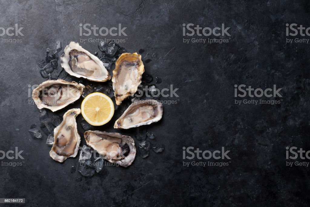 Oysters and lemon stock photo