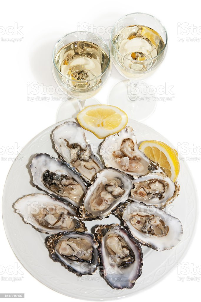 Oysters and wine on white background stock photo
