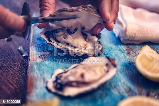Oysters served on a plate with ice and lemon