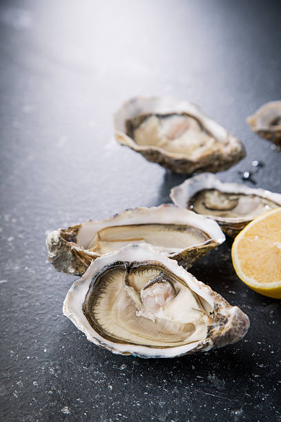 Oysters On The Half Shell Stock Photos, Pictures & Royalty ...