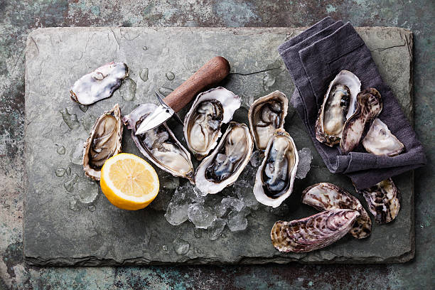 Oysters with ice and lemon stock photo