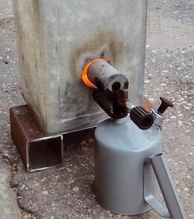 istock pable lamp heats the steel tank. 1255456927