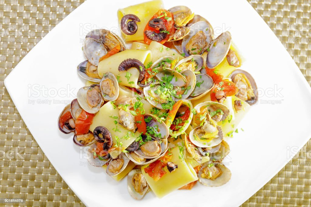 Paccheri, clams and octopus. Pasta with clams. stock photo