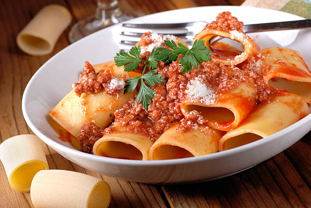 Paccheri Neapolitans with meat sauce Paccheri Neapolitans with meat sauce in the white dish ragout stock pictures, royalty-free photos & images