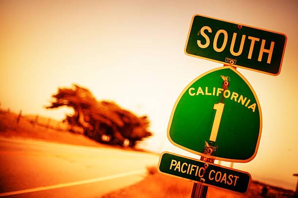 pacific coast highway road sign - süd kalifornien stock-fotos und bilder