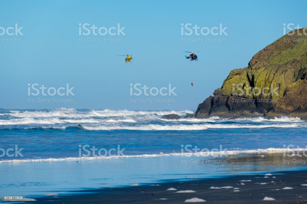 Pacific coast, USA. Coast guard helicopters in the sky. stock photo