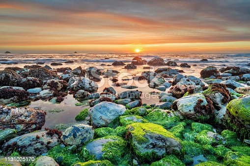 Stock photograph of the Pacific coastline at Big Sur, California, USA, during sunset.