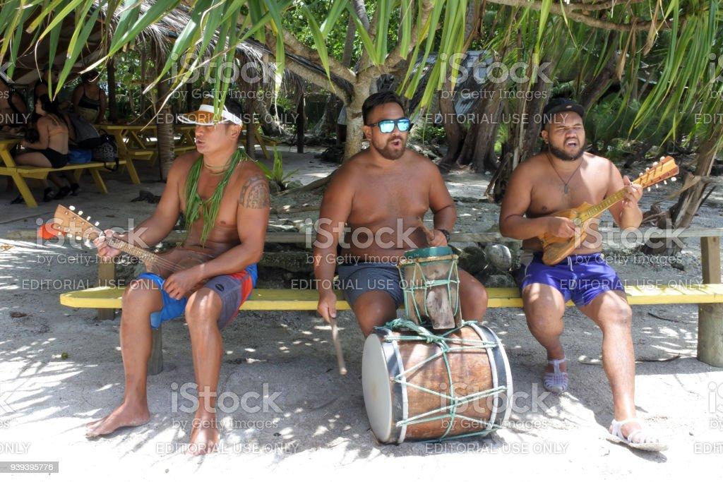 Pacific Island men play music in Rarotonga Cook Islands stock photo