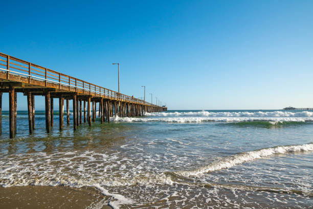 pacific ocean and long wooden pier - central coast california stock photos and pictures