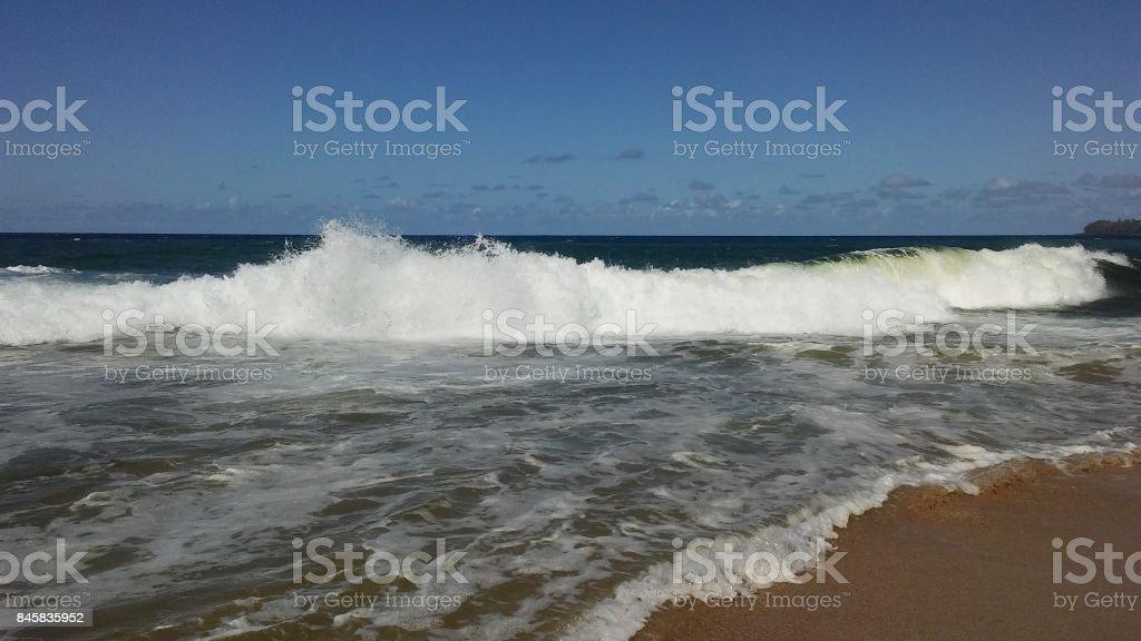 Pacific Ocean Waves on Lumahai Beach on Kauai Island, Hawaii. stock photo