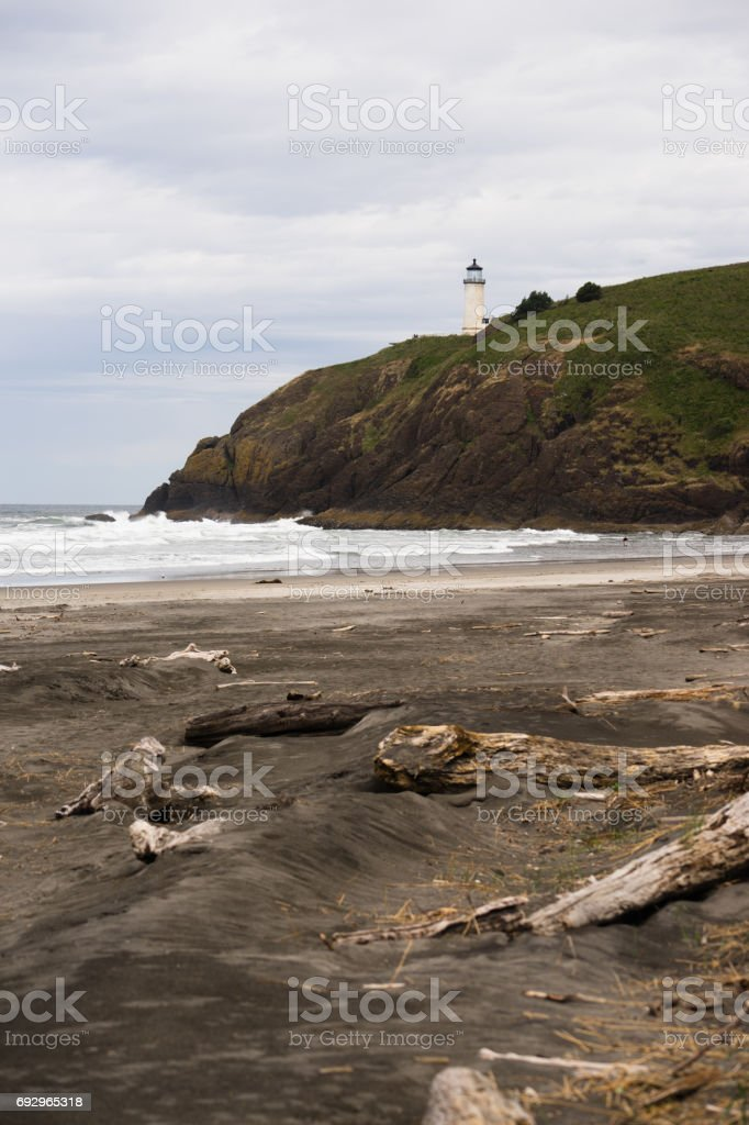 Pacific Ocean West Coast Beach Driftwood North Head Lighthouse stock photo