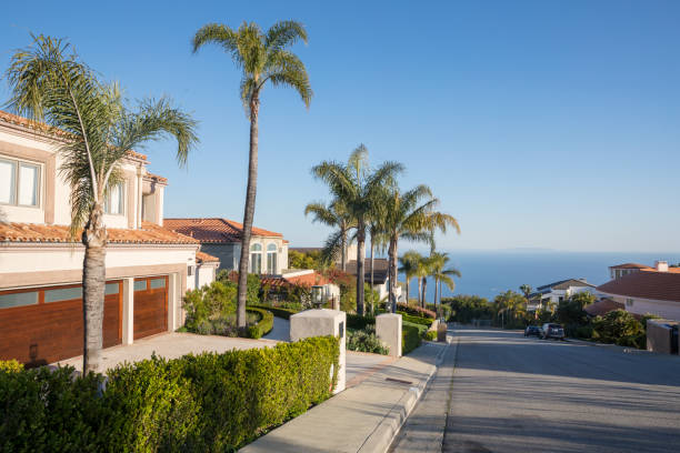 Pacific Palisades street with palm trees and ocean view. Southern California stock photo