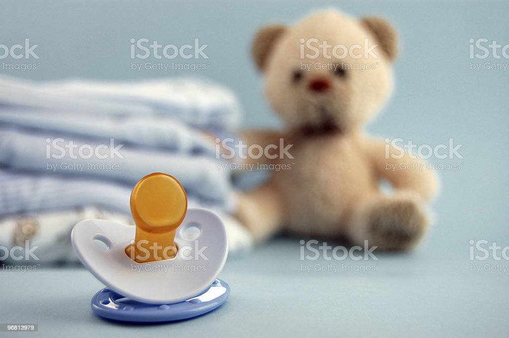 Pacifier and Baby Clothes stock photo