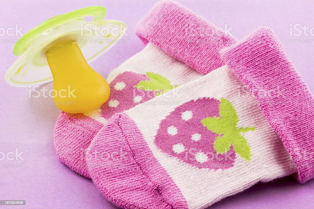 Pacifier and socks royalty-free stock photo