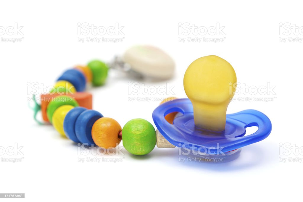 Pacifier and Wooden Beads stock photo