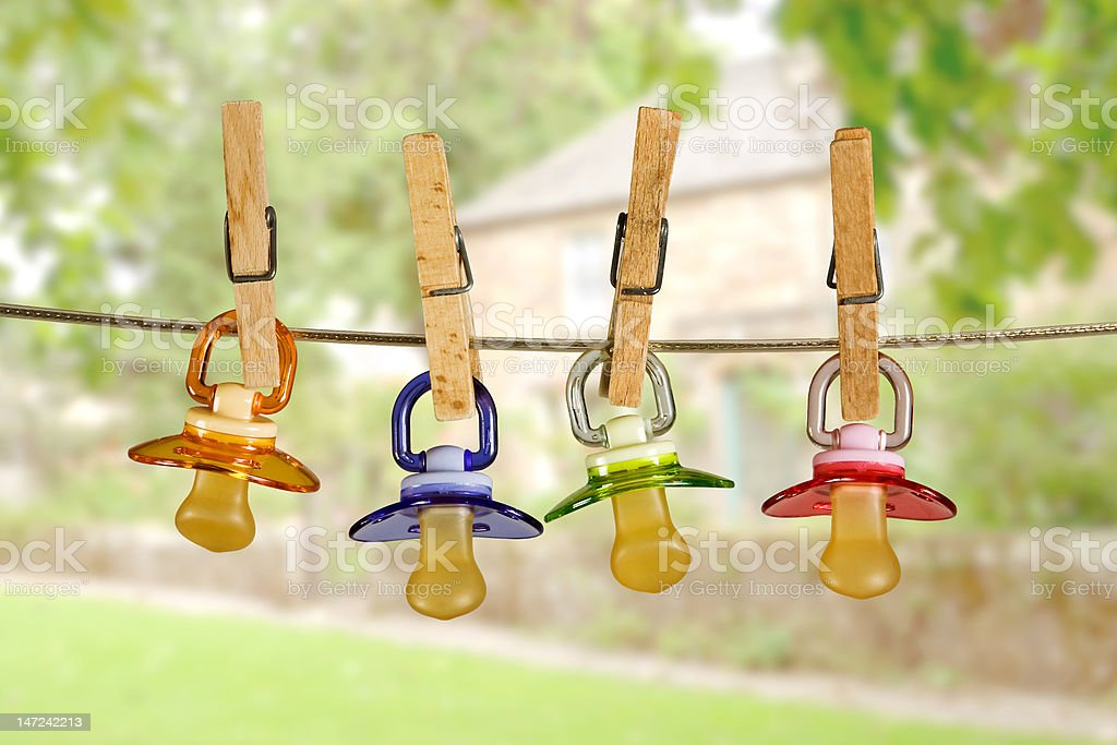 Pacifiers in line stock photo