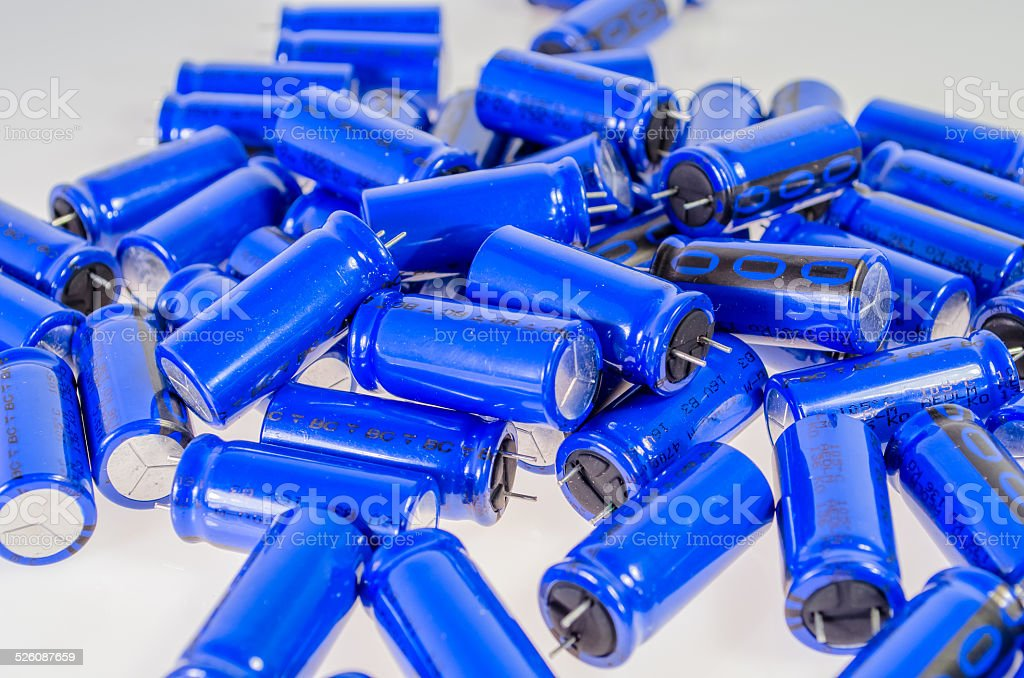 pack of capacitors on a white layer stock photo