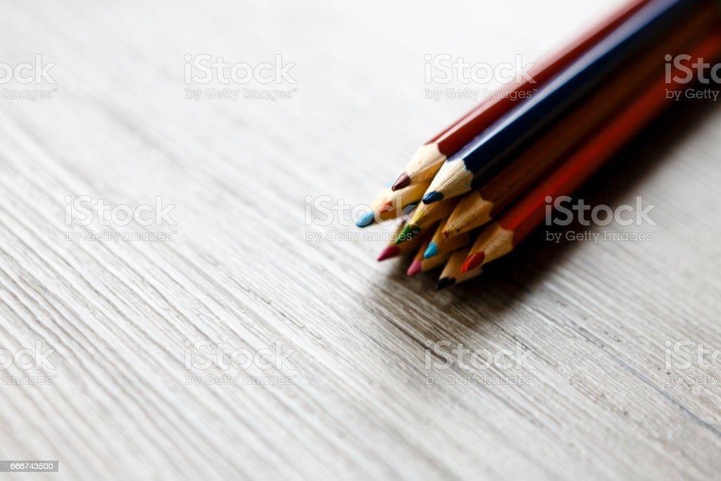 pack of color pencils or pastel on wooden floor foto stock royalty-free