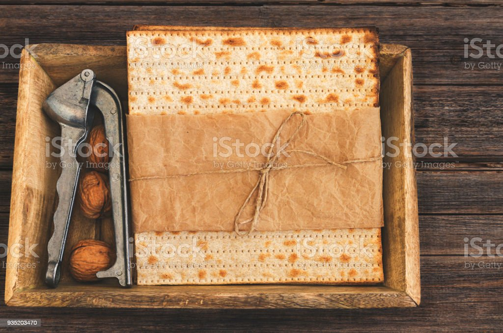 Pack of matzah or matza on a vintage wood background presented as a gift with copy space. stock photo