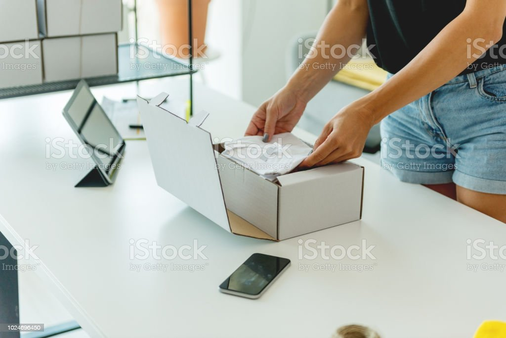 Pack the merchandise for sending stock photo