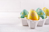 istock Package box with painted easter eggs. Easter holiday background. Copy space 1098416228