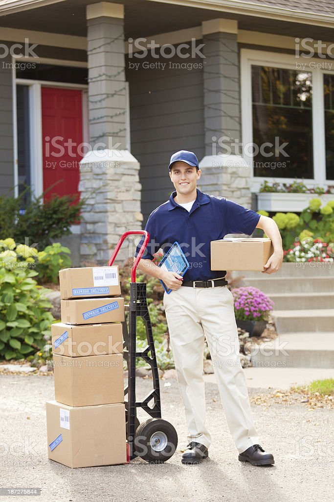 Package Delivery Man with Packages at Customer's Home stock photo
