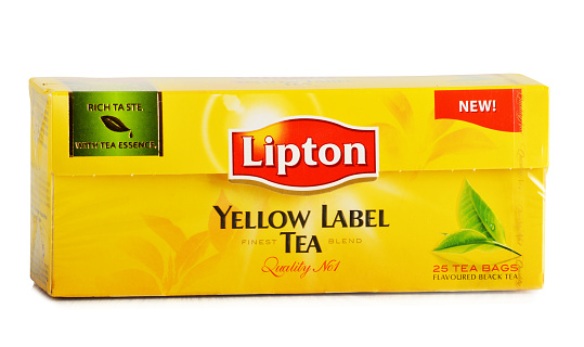 istock Package of Lipton Yellow Label tea isolated on white 525061859