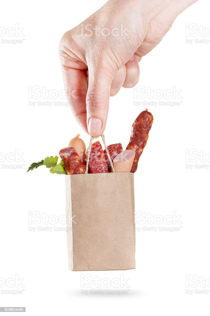 Package of sausage set in hand. Concept sale and delivery stock photo