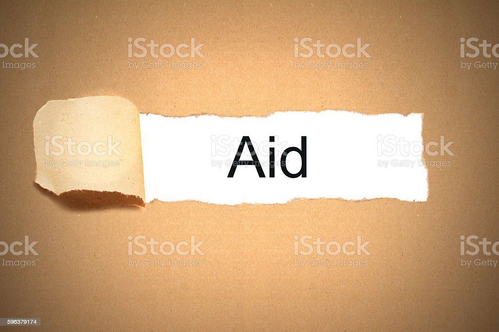 package paper carton torn to reveal white space aid stock photo