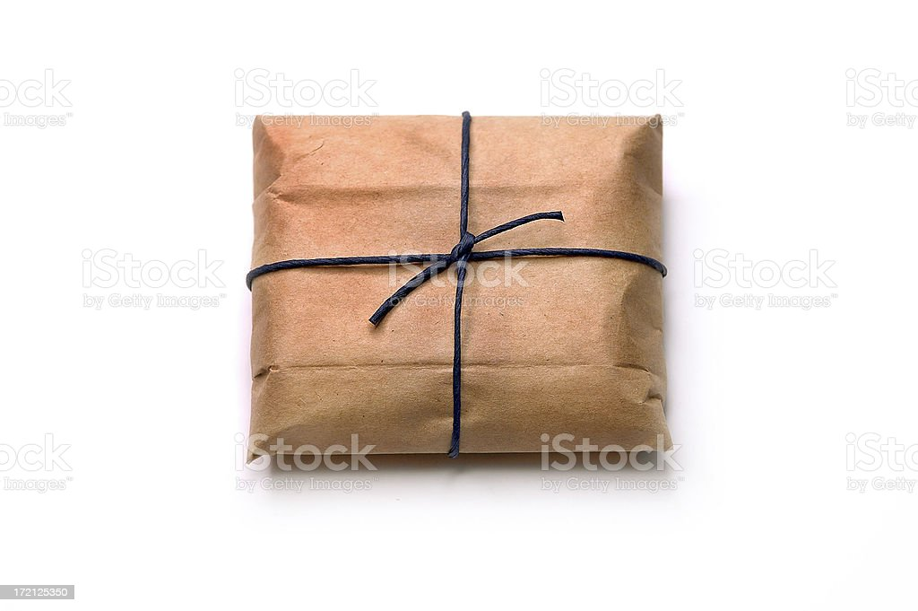 A package, wrapped in brown paper and tied with string royalty-free stock photo