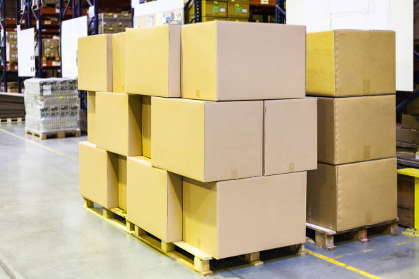 packaged boxes and cartons on wooden pallets stock photo