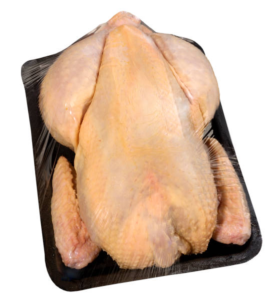 Packaged chicken in a plastic tray stock photo
