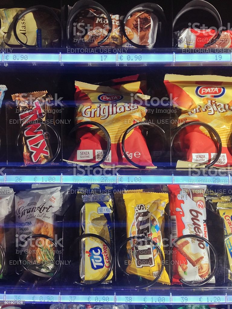 Packaged junk food in vending machine stock photo