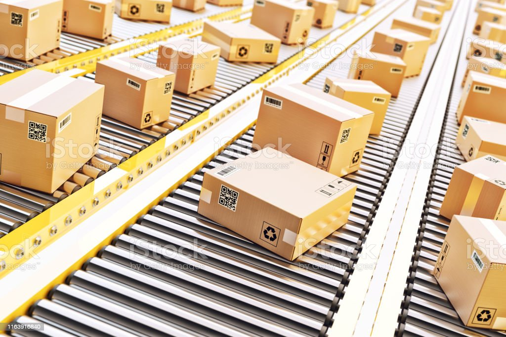 Packages delivery, packaging service and parcels transportation system concept Cardboard boxes on a conveyor line in distribution warehouse Automated Stock Photo