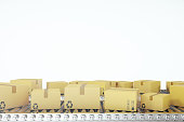 istock Packages delivery, packaging service and parcels transportation system concept, cardboard boxes on conveyor belt, 3d rendering 664028944